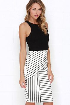 Sweeter than sugar, the Kiss Cross Black and Ivory Striped Midi Dress will be a darling addition to your collection of pretty midis! A textured, medium-weight stretch knit bodice has flattering princess seams that travel to a banded waist. The ivory ribbed knit skirt steals the show with its crossing striped pattern, and body-skimming fit. Hidden back zipper.