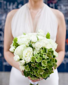 This bride carried a classic summer bouquet of green-and-white flowers at this destination wedding in Paris.