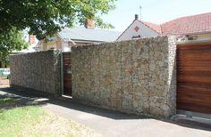 See more amazing gabion wall projects at gabionwallexpert.com #gabion #gardendesign #gabionwall #gabions #mesh