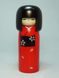 Haregi. Type: shingata kokeshi Wood: body in cherry tree, head in chestnut tree, face in dogwood Dimensions: height 19cm (7.6inches) Handmade and handpainted in Japan