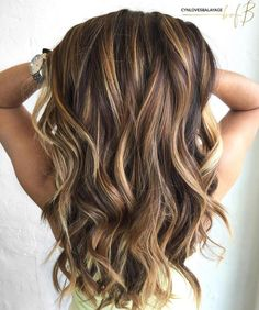 #11: Caramel Highlights and Tousled Waves Golden highlights and undone waves are an unbeatable combination. To add a bit more dimension to your locks, contrast