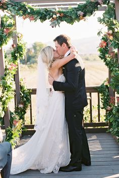 Photography :  Lane Dittoe Fine Wedding Photographs | Dress :   Lazaro | Grooms Suit : Hugo Boss Read More on SMP: http://www.stylemepretty.com/2014/02/19/classic-santa-barbara-wedding-at-apple-creek-ranch  For more Santa Barbara Wedding Florist: http://www.weddingtrendsandtraditions.com/santa-barbara-wedding-florist-wedding-floral-designer