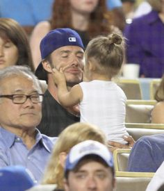 And yanking his cheeks. | These Photos Of David And Harper Beckham Will Melt Your Heart