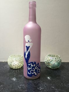 Pink glass wine bottle with woman in blue dress with rhinestones Wine Bottle Glasses, Wine Bottle Art, Glass Bottle Crafts, Bottle Lamps, Painted Glass Bottles, Decorated Bottles, Wine Glass Drawing, Bottle Centerpieces, Bottle Jewelry