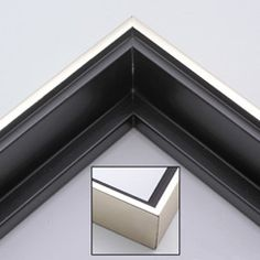 "This solid wood canvas floater picture frame features a shiny brushed silver on the outside edge and narrow face.  The long inside step and base are a matte black.   Display your favourite gallery wrapped canvas Giclée print or oil painting with authentic, fine art style. This canvas floating frame is ideal for large, thich (1.5 "" deep) canvas images.  *Note: These canvas floaters are for stretched canvas prints and paintings, and raised wood panels."