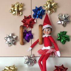 19th December 2014. Ellie Elf on the shelf has placed bows that were meant for presents on my cupboard doors, but it does look pretty #elfontheshelf