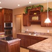 Kitchen with Seneca Ridge cherry paprika cabinets, decorative plate holder by Rochester Homes | www.rochesterhomesinc.com