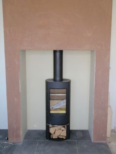 Scan 45 mini works well in this situation as it is tall and slim, installed by Kernow Fires.   #scan #mini #fire #stove #wood #burner #tall #thin #fireplace #modern #contemporary #log #store #kernowfires #wadebridge #redruth #cornwall