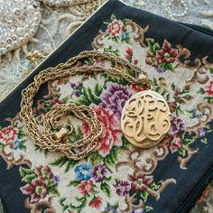 VINTAGE . initial filagree locket on chain . vintage . no makers mark  . gold tone . well constructed . 1960s ish  . excellent vintage shape. Normal wear. Jewelry Necklaces