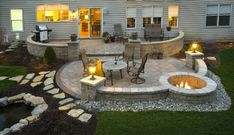 Lay a paver patio with dual access from the kitchen and open-air sunroom. Include spaces for food prep and dining, and possibly a fire pit