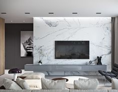 Marble isn't just for floors anymore. This slab-style wall brings this livin… Marble isn't just for floors anymore. This slab-style wall brings this living room from simple to spectacular. Living Room Interior, Home Living Room, Home Interior Design, Living Room Decor, Design Interiors, Tv Wall Design, House Design, Feature Wall Living Room, Tv Feature Wall
