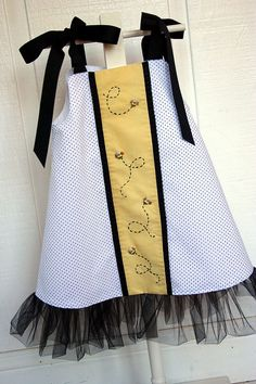 Honey Bee tutu dress  Pattern is Tana Tutu by Nanoo designs.White and black dot fabric is by Fabric Finders and yellow slide is by Nashville Cotton. @Katy Mitchell  @Becky D.
