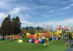 The unique feature of the Heather Farm playground in Walnut Creek is a set of artificial-turf covered mounds that children can slide down