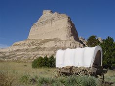 Scotts Bluff on their way west on the Emigrant Trail to Oregon, and later California and Utah. Wagon trains used the bluff as a major landmark for navigation. The trail passed through Mitchell Pass, a gap in the bluffs flanked by two large cliffs. Passage through Mitchell Pass became a significant milestone for many wagon trains on their way westward.