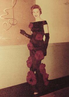 Pattern Maker and Designer Rita Rava-Mikols modeling her award winning dress at Art Institute Fashion Show