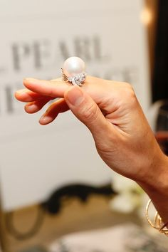 """Heidi Hong looks at a Mikimoto cultured pearl ring during the Mikimoto """"The Pearl Necklace"""" installation debut and book launch benefiting OCEANA and in conjunction with Assouline Publishing at South Coast Plaza on Thursday, October 13, 2016, in Costa Mesa, California."""