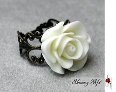 Vintage Inspired Blooming White Rose Flower Resin Ring. $3.99, via Etsy.