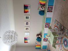 Ikea playroom storage. Love the gray with rainbow colors!
