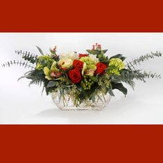 HOLIDAY MAGIC:  Believe in the magic of the holidays, with this exquisite piece. Our most popular selling vase, a glass waffle etched flat fishbowl, with a stunning assortment of orchids, roses, kale, berries, green hydrangea, and mixed greens.    #MatlackFlorist