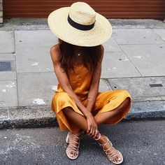 This silk burnt orange dress and oversized straw hat combo is a major summertime look #AsSeenOnMe
