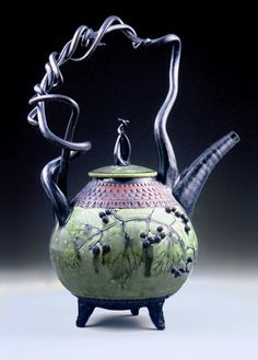 """""""Basket Handled Teapot""""  Ceramic Teapot    Created by Suzanne Crane  Wheel-thrown and handbuilt stoneware teapot decorated with a hand-pressed scale pattern. Green copper-ash glaze with black trim and red iron oxide detailing. Botanical specimens vary seasonally. Food and dishwasher safe."""