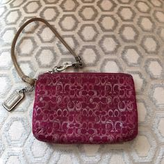 Coach Pink Signature C Wristlet Zip closure.  Hang tag.  Silver hardware.  Lightly dirty.  Measures: 6x4. Leather strap. Coach Bags Clutches & Wristlets