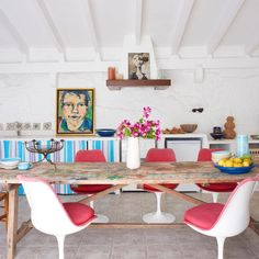 // INSPIRATION // Eclectic mix of country table and mid century Saarinen chairs.