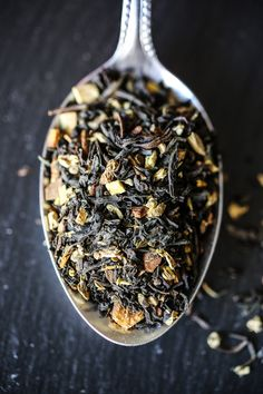 Black tea - A spoon fill of black tea leaves, spices.