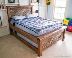 DIY farmhouse pallet bed built with Anna White's plans and added details.