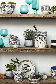 Never neglect your shelves. Make them as pretty as the rest of you home with these hand painted stoneware pieces.Would be pretty mixed with blue and mint colored dishes. Decoration Bedroom, Room Decor, Kitchen Shelves, Kitchen Decor, Glass Shelves, Kitchen Stuff, Kitchen Ideas, Anthropologie Home, Interior Decorating