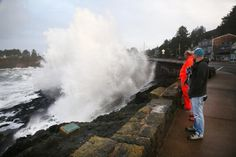 One person was reported swept out to sea and another had been injured as wild seas battered the coastline.