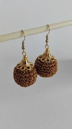 Hi! Thanks for visiting my etsy shop :)  Crochet is one of my many weaknesses. And a wonderful passion of mine.  Earrings crocheted around a 20mm wooden bead with golden cord . Will look very elegant together with evening wear. At a wedding :)  *Nickel free  Drop length 2,36 inches / 6 cm  Shipping: Courier Companies, Pearl Earrings, Drop Earrings, Wooden Beads, Cord, My Etsy Shop, Take That, Passion, Elegant