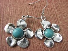 These lovely turquoise colour flower dangle earrings are made from tibet silver alloy and has faux turquoise stone in the middle    Size : 3 cm diameter, 5 cm drop including hook    Weight : 14 gms    Pre order NOW to reserve ! - stock will arrive in Aus first week July