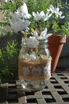 trio of Baby White Bows Mason jar wrapped in burlap with 3 white bows shabby chic home decor