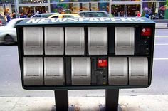 A newspaper vending machine that dispenses content in electronic form only