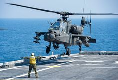 An Army AH-64D Apache helicopter prepares to land aboard the USS Ponce