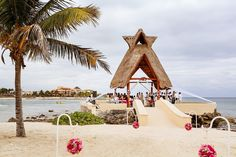 Mexico Destination Wedding Dreams Puerto Aventuras, the gazebo on the Mexican Caribbean Sea is simply stunning, even on a cloudy day!  Mexico photographers Del Sol Photography