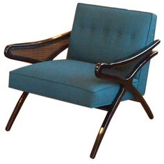 Scissor Armed Ebonzied Chair  USA  1950's  An unexpected mix of materials—beech wood French polished to an espresso color, handwoven caning and teal upholstered seat—add a great modern mix to the room.
