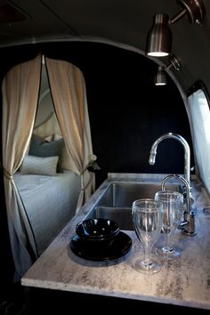 Airstream - Glamping! Trailer/camper with black walls paint color and black kitchen ...