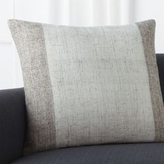 Emphasizing the natural beauty of woven fabric, Mariella Ienna has created a simply beautiful, two-tone pillow.  Flecked in coordinating colors, the textural pillow centers a broad band of ivory between borders of neutral taupe. Our decorative pillows include your choice of a plush feather-down or lofty down-alternative insert at no extra cost.
