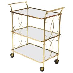 Mid-Century Italian Brass Bar Cart | From a unique collection of antique and modern bar carts at https://www.1stdibs.com/furniture/tables/bar-carts/