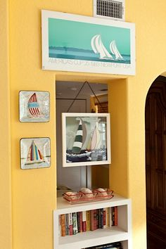 Nautical decor with sailboat art.