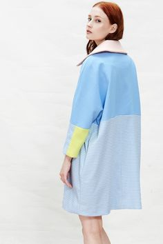 """Pastel Cocoon Coat - This vintage inspired coat is done in a pastel blue color with contrasting salmon-pink collar and yellow sleeves. The rounded cocoon shape pairs well over knits and skinny jeans or over a dress so you can stay warm and still look stylish. The bottom half is composed of a herringbone pattern. Buttons up the front, sleeves are 3/4 length. Fully lined, medium weight, non-stretch. Model is 5'7"""" and is a size XS"""