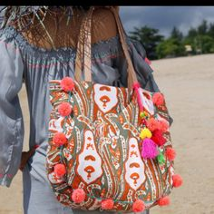 New in store now available in Orange our Trendy Pompom beach bag!!