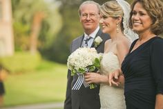 Bride walking down the aisle with mum and dad - look how proud her dad looks! | Orange Turtle Photography via Bridal Musings