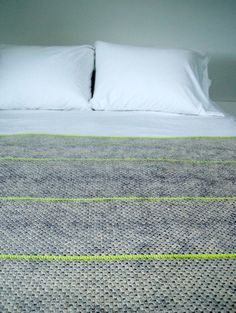 Modern grey blanket with bright stripe