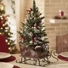 Elegant And Beautiful Tabletop Christmas Tree Centerpieces Ideas 30 Centerpiece Christmas, Pine Cone Christmas Decorations, Christmas Sled, Tabletop Christmas Tree, Tree Centerpieces, Small Christmas Trees, Christmas Arrangements, Primitive Christmas, Country Christmas
