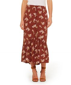 Get ready for summer with the Secret Garden Midaxi Skirt. This vintage inspired skirt features fixed waistband, button front with peplum hem.
