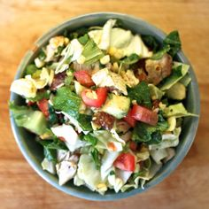 Get ready for spring with a healthy chopped salad with bacon, avocado, roasted corn, and chicken.