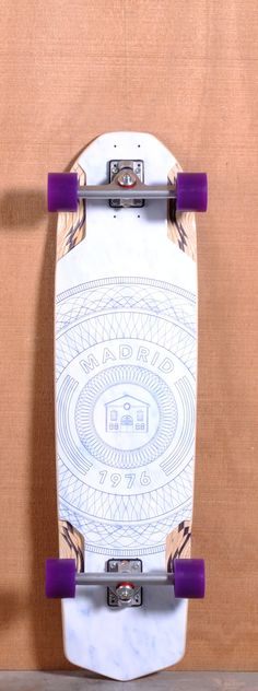 """The Madrid Circles Longboard Complete is designed for Freeride and Downhill. Ships fully assembled and ready to skate!  Function: Freeride, Downhill  Features: Rocker, W Concave, Flared CNC Wheel Wells, Kick Tail  Material: 8 Ply Maple  Length: 37.375""""  Width: 9.375""""  Wheelbase: 29.5""""  Thickness: 9/16""""  Hole Pattern: New School  Grip: Black"""